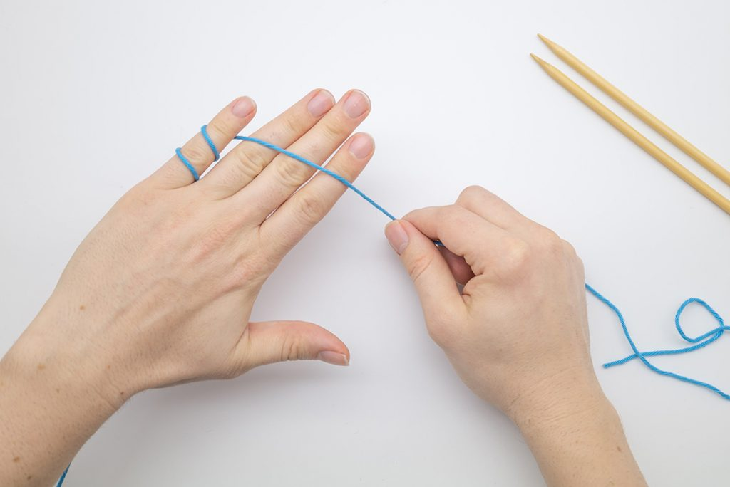 bring the yarn across the back of your fingers