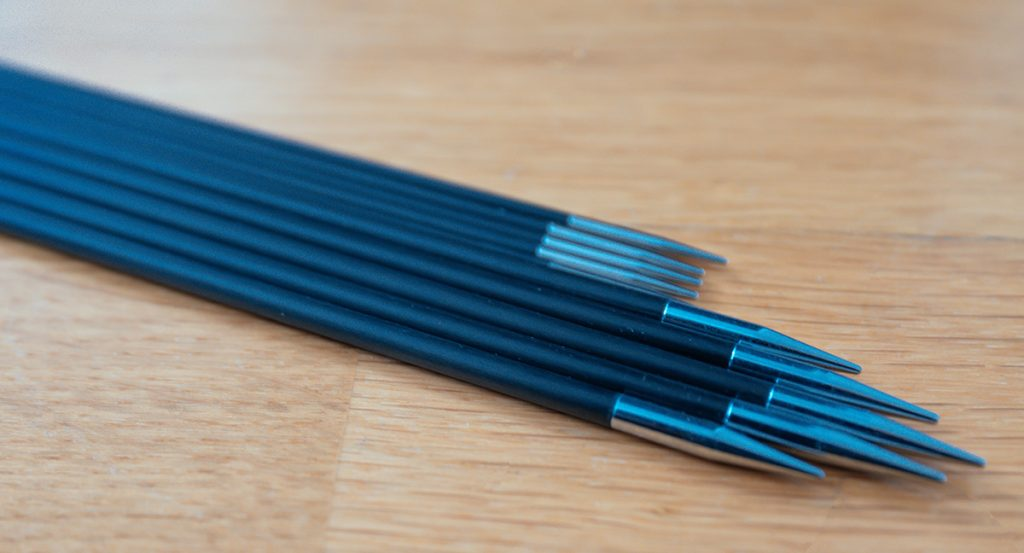 a couple of carbon knitting needles for circular knitters