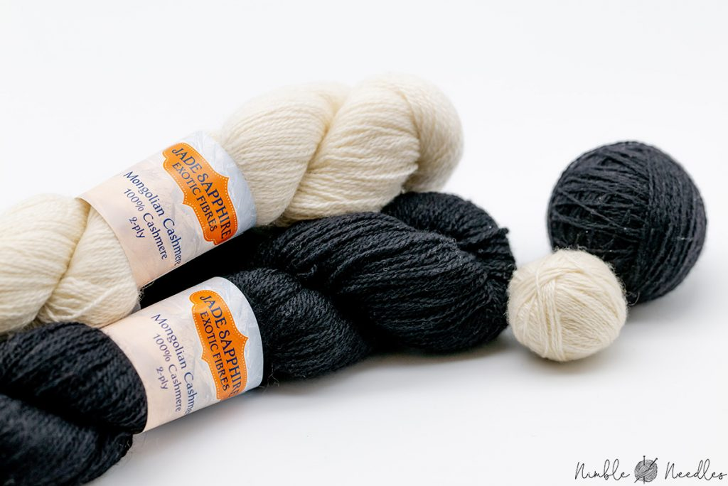 a set of black and white cashmer yarn skins in 2ply