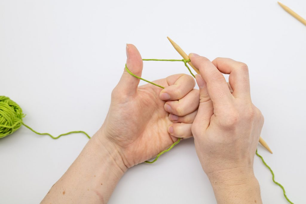 create a loop around your thumb