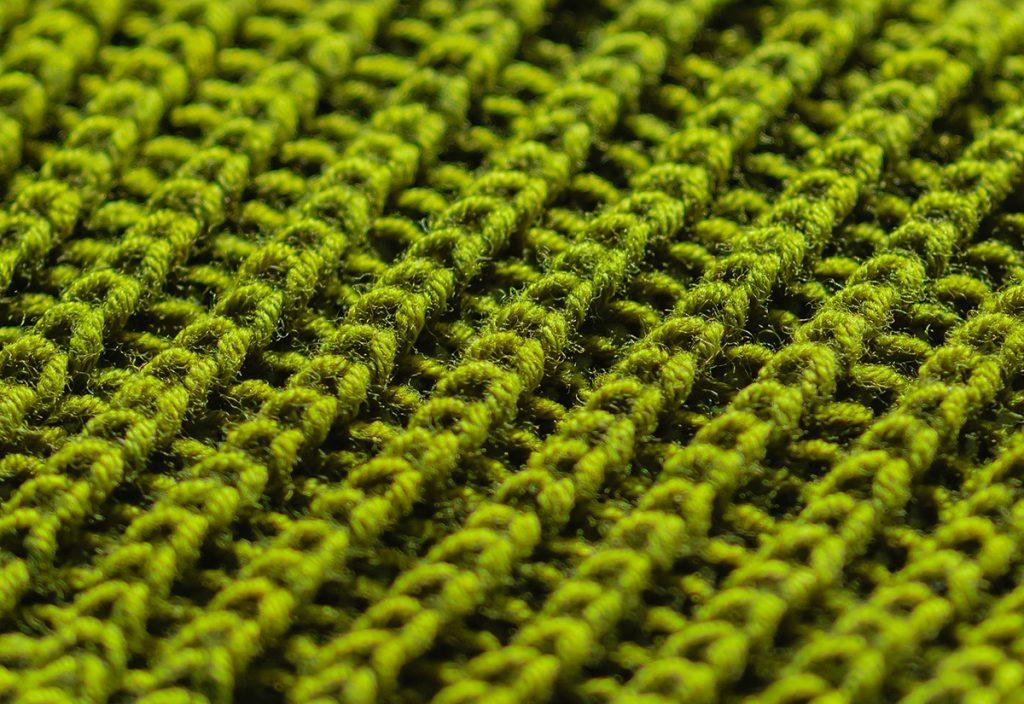 The right side of a half brioche stitch knitting work