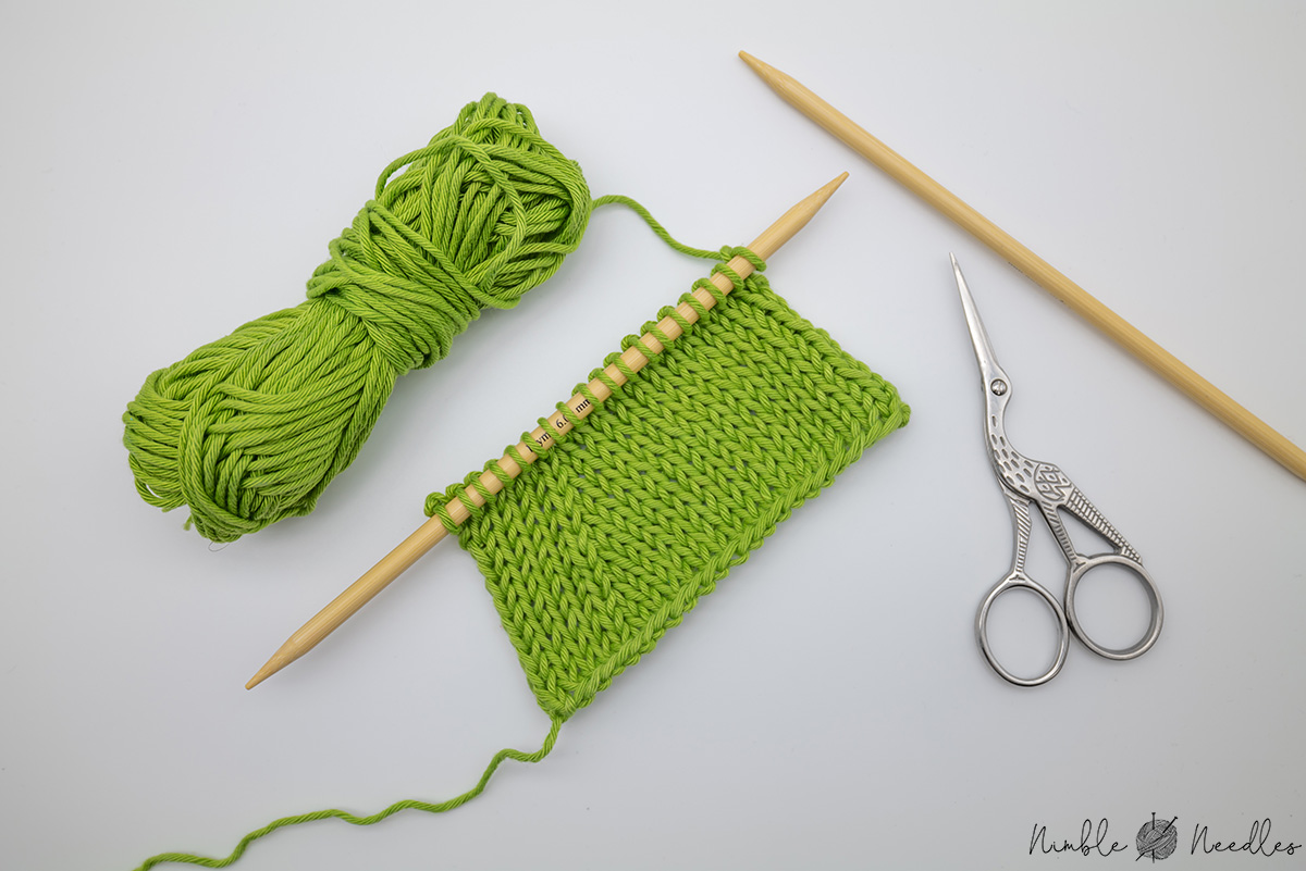 how to knit 2 stitches together - a sample patch on the needle with right leaning k2tog stitches