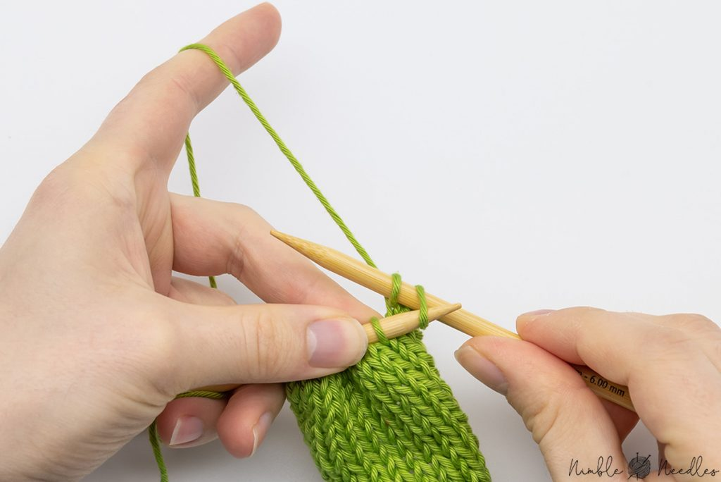 insert the left needle into the first stitch