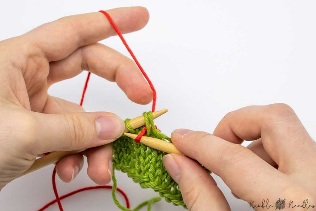 Pull the yarn through two stitches to knit two together