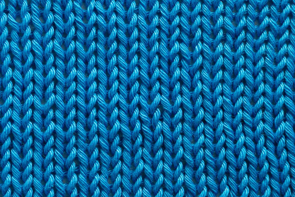 Close up of a stockinette stitch knitting pattern