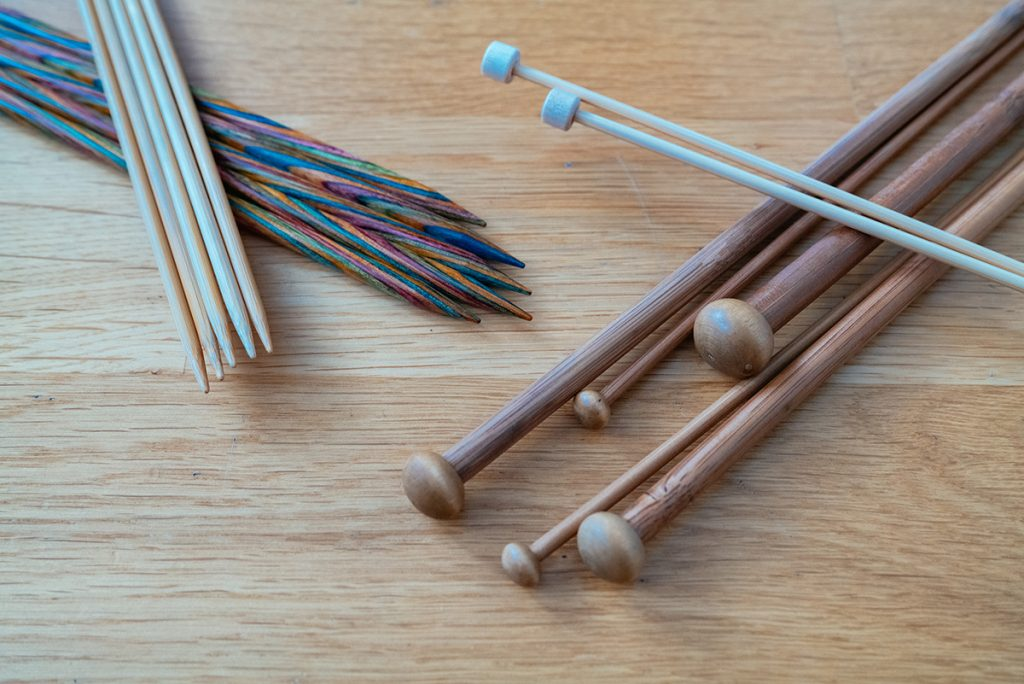 Different knitting needles made of wood (bamboo, birch, etc). double point and singe point needles.