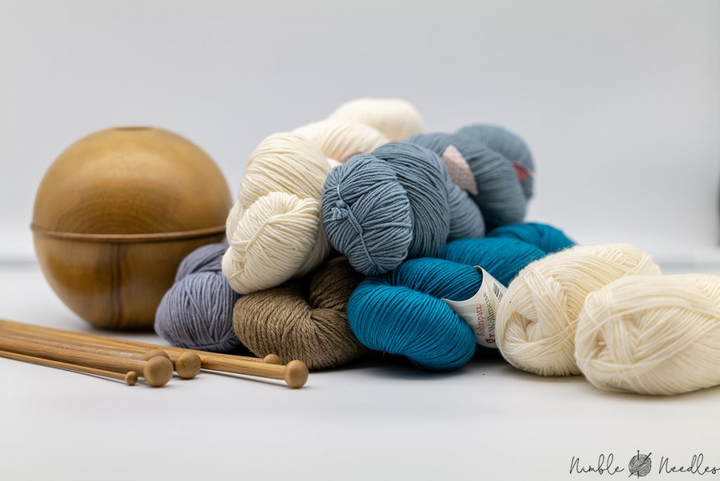 different hanks and skeins of wool yarns in different colors