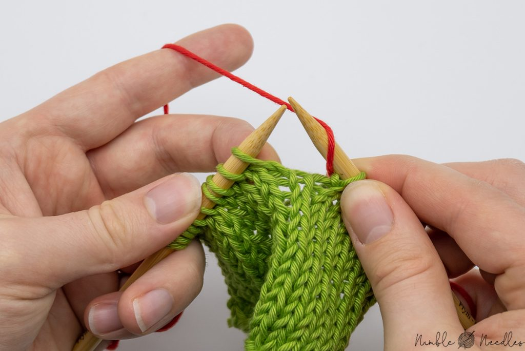 wrap the yarn counter clockwise around the right needle once to yarn over