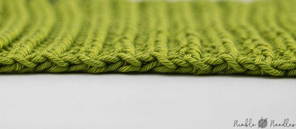 the classic longtail bind of on a twisted rib stitch swatch
