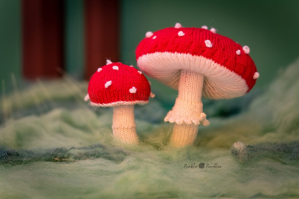 A knitted toadstool in a forest