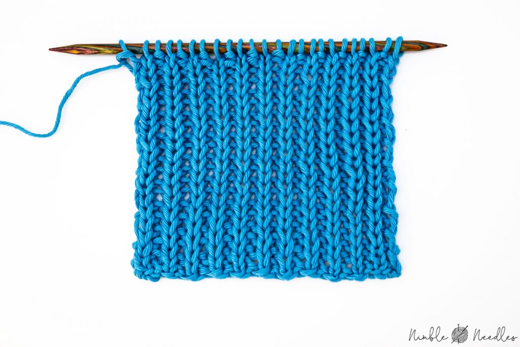 Knitting a swatch in 1x1 rib stitch on the needles