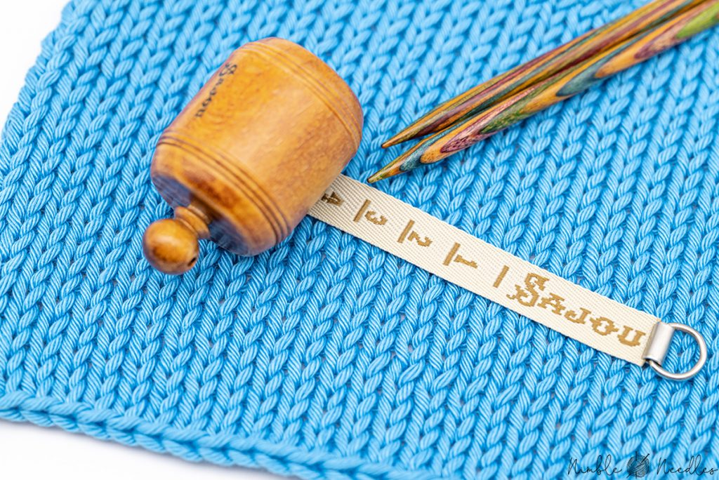 Counting the stitches per inch to find out how much yarn to cast on
