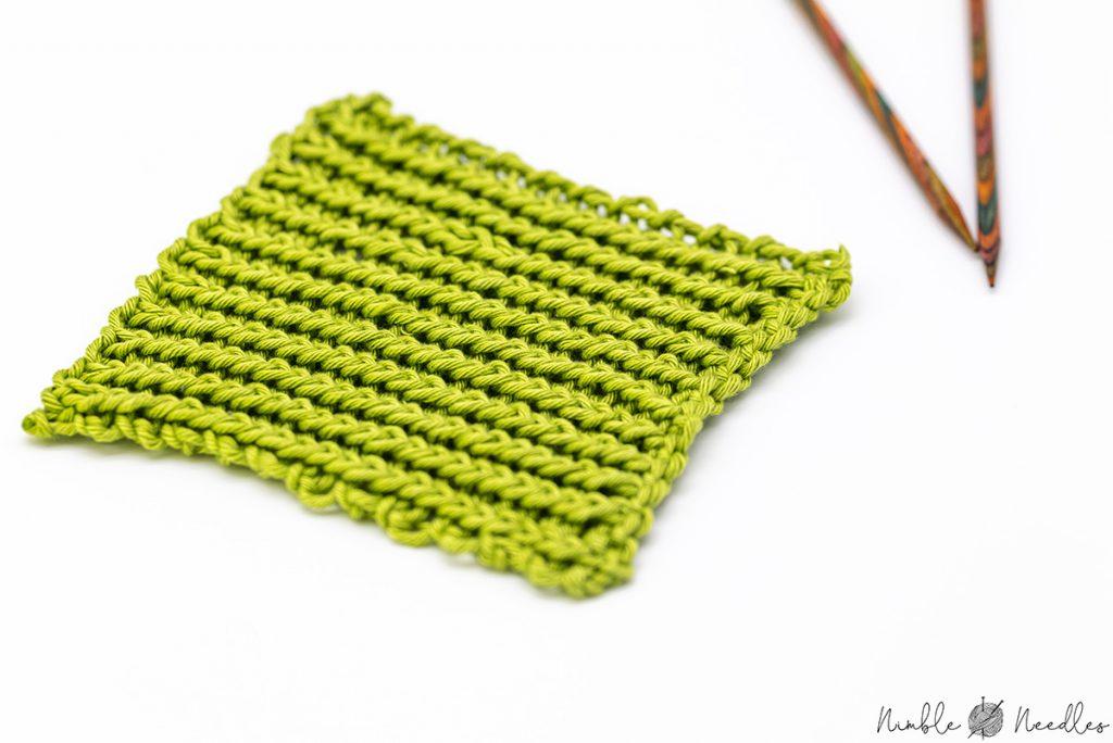Close up of a twisted rib stitch knitting swatch