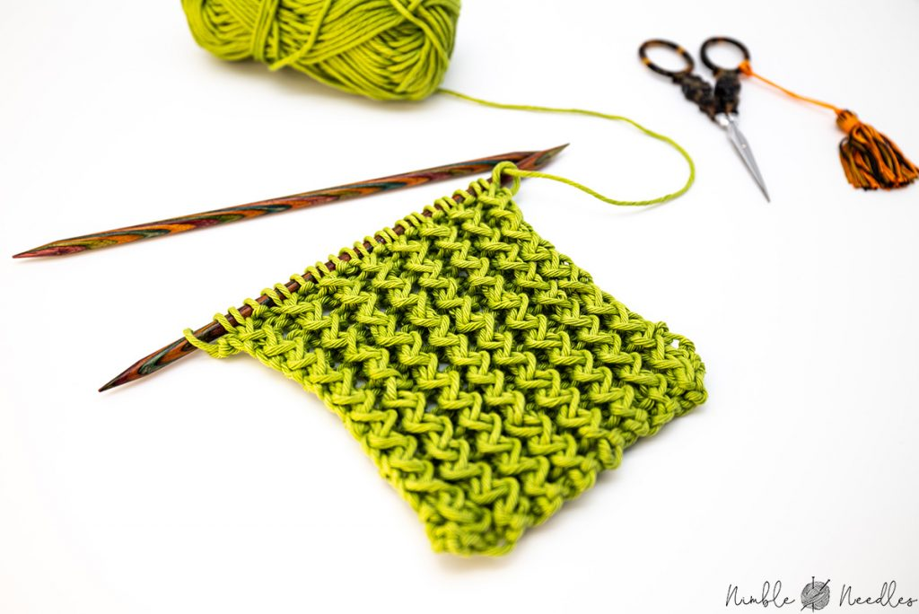 a close up of a zig zag rib stitch swatch on the needles