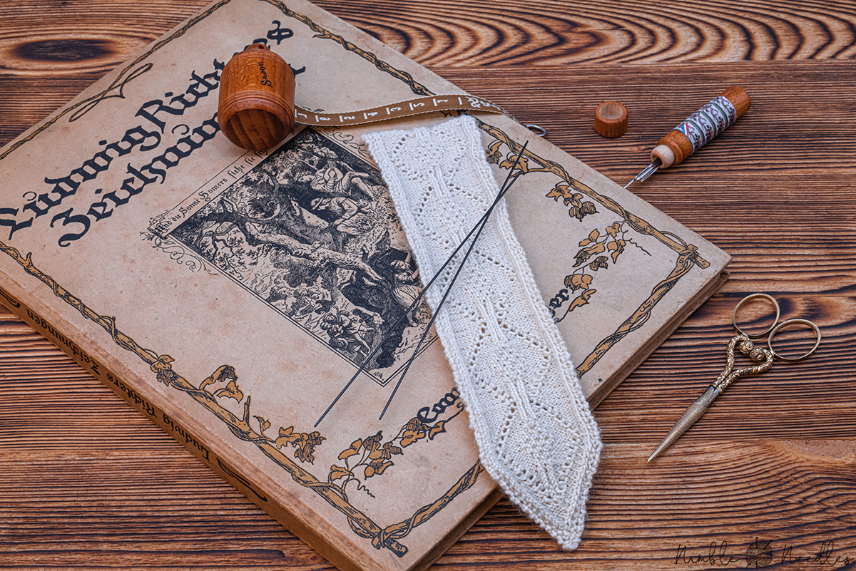 another picture of the knitted lace bookmark on an ancient book