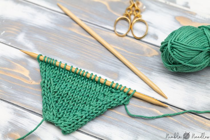 close-up of a green swatch increases with kfb (knit front back) and kfsb