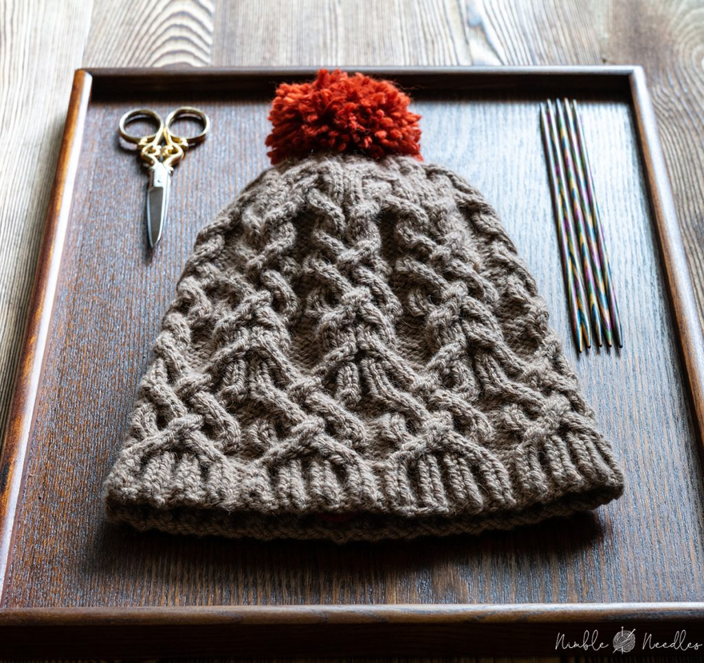 a cable hat knit with camel hair yarn