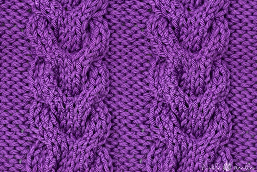 A swatch with a horseshoe cable stitch pattern also known as double cable stitch