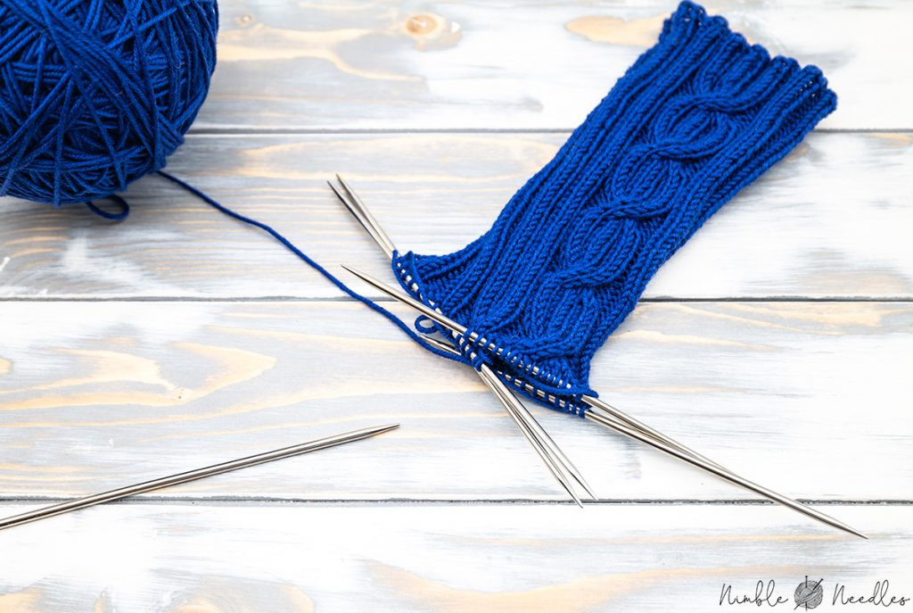 knitting the shaft of these cable socks
