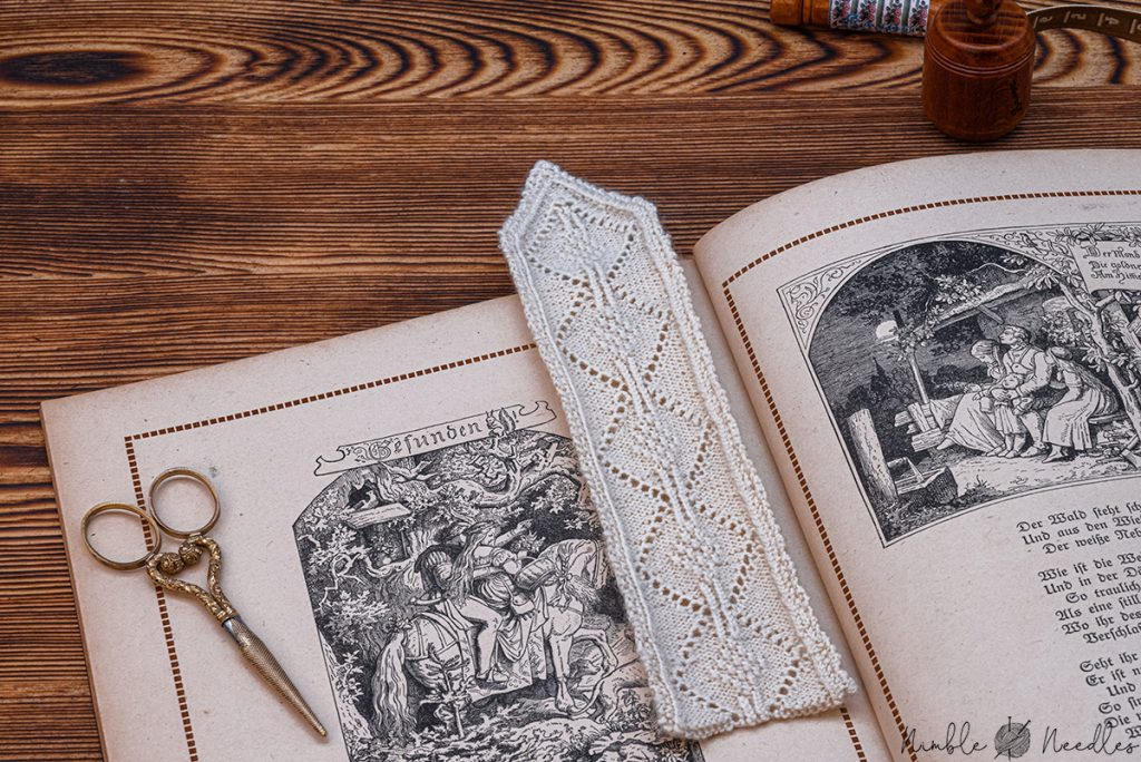 A very fine knitted bookmark in an acient book