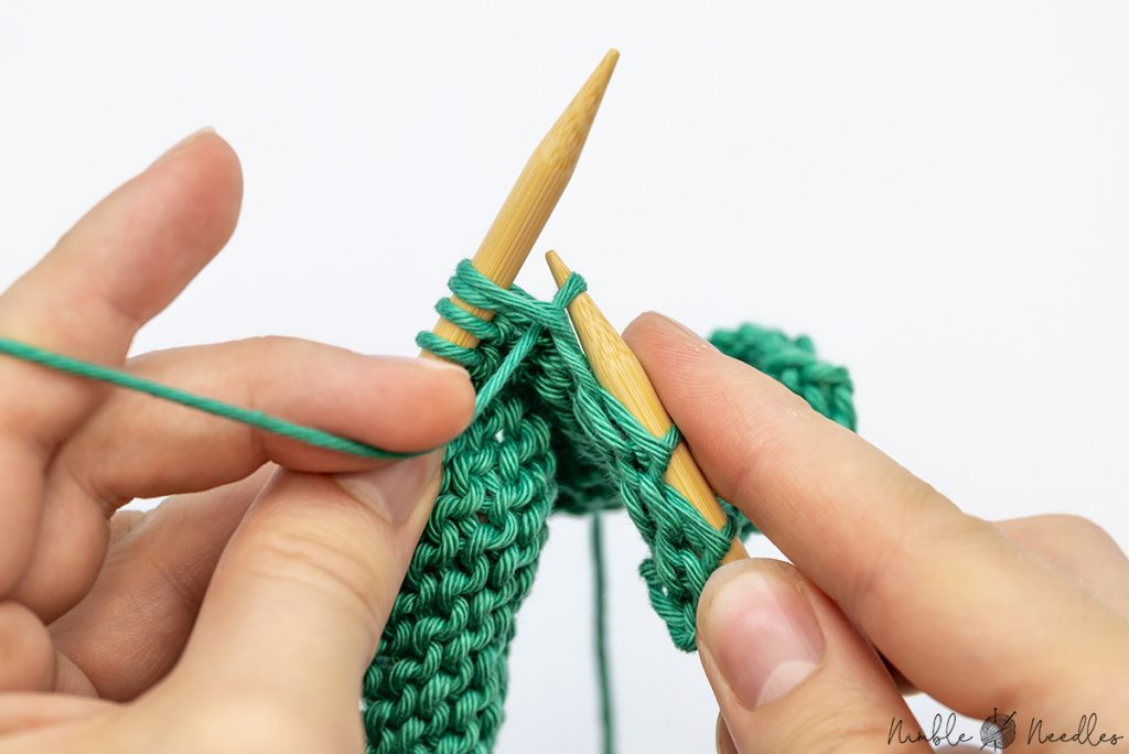 Pull the yarn through the two stitches to p2tog