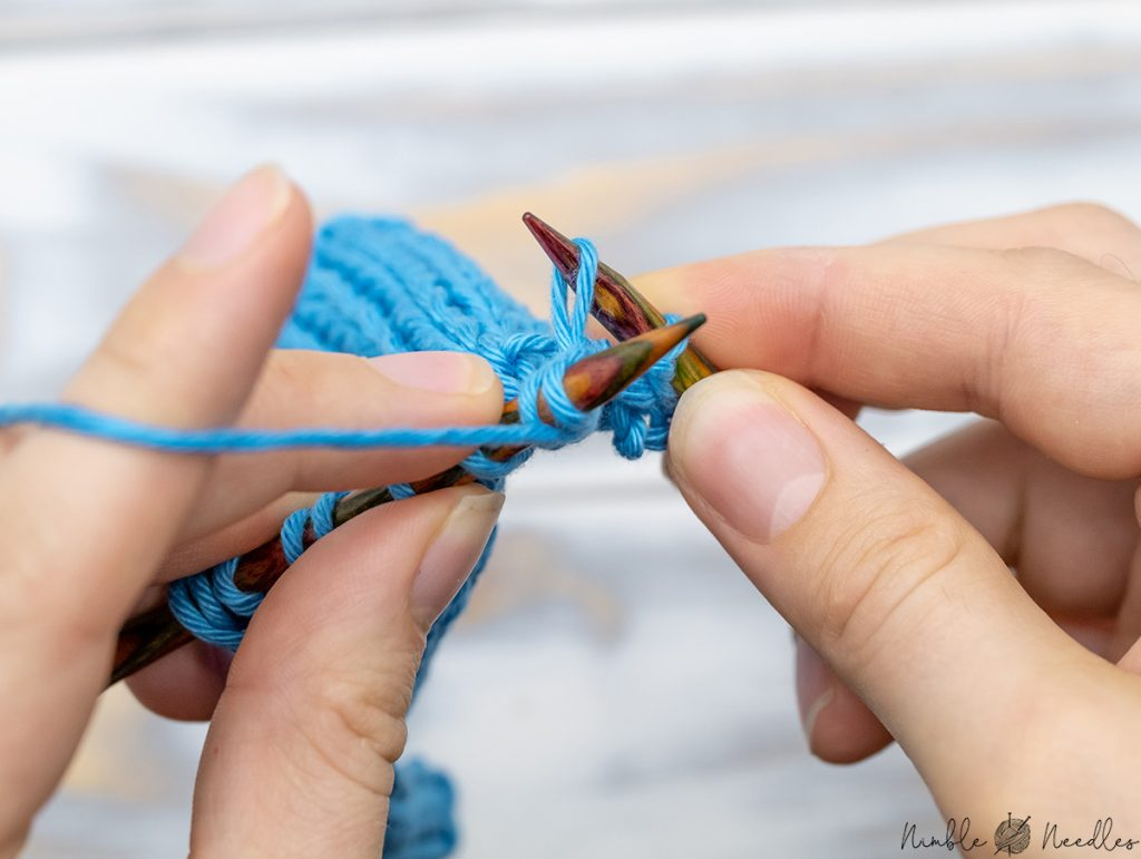and pull  the yarn through both stitches to p2tog tbl