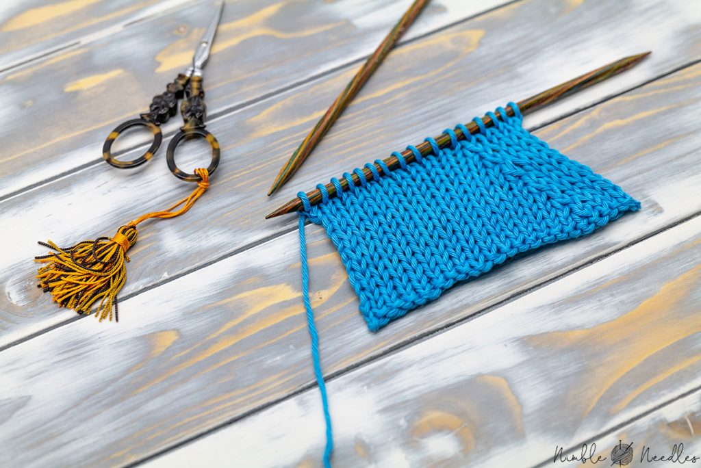 the knit side of a swatch with p2tog tbl decreases on the purl side