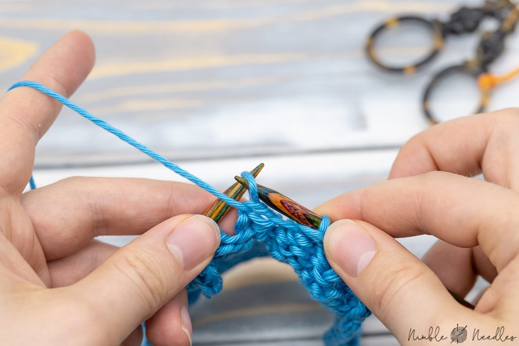 slip the purl stitch back on the right needle. and that's your p2tog tbl alternative