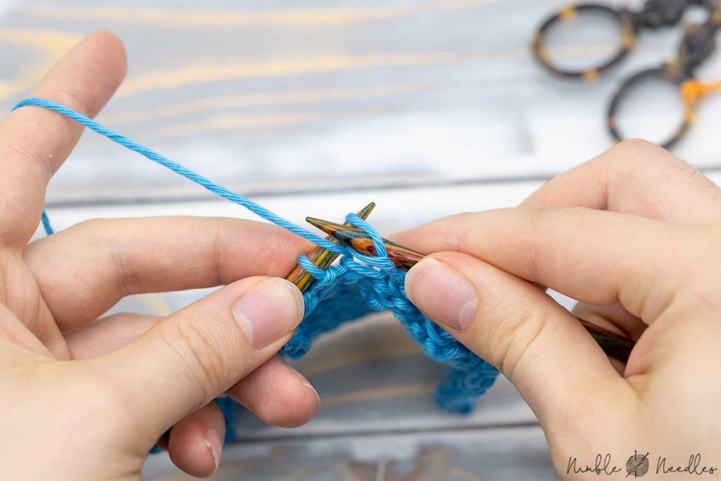 slip the stitch back on the left needle