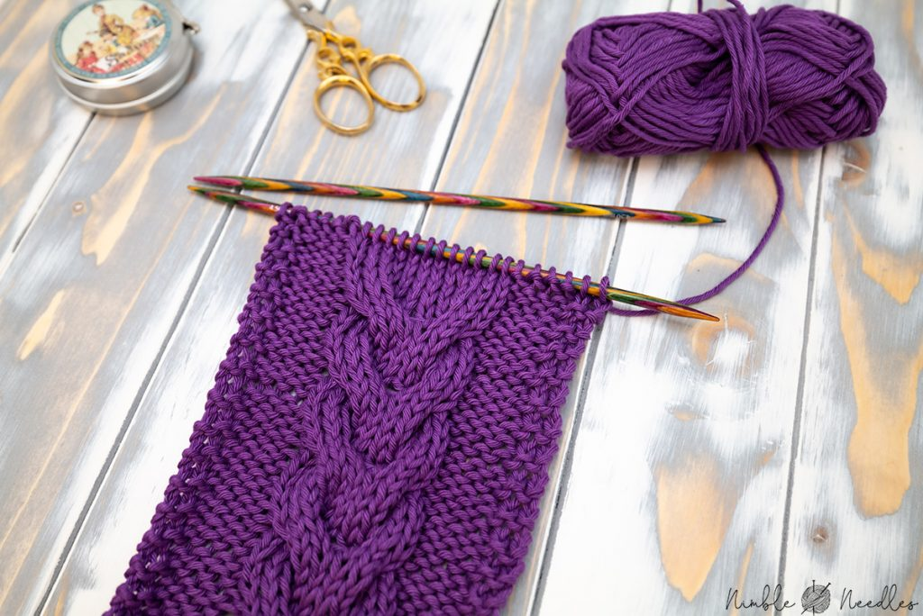 A swatch in the wishbone cable stitch