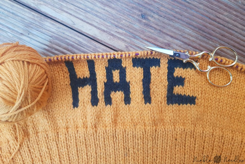"backside of intarsia sweater saying ""hate"""