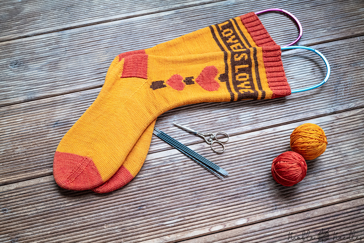 Pride socks knitting pattern: Love is Love [using intarsia in the round]