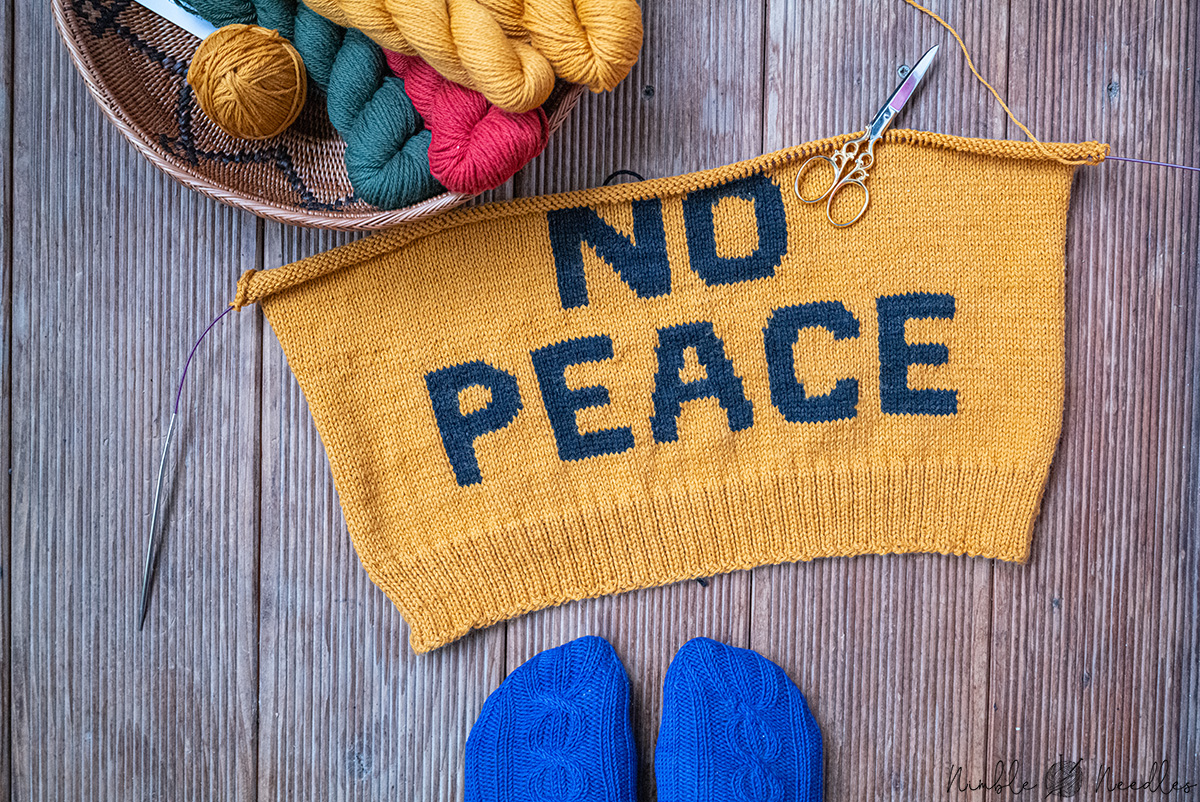 """View of the front of my love sweater with """"no peace"""" in intarsia technique"""