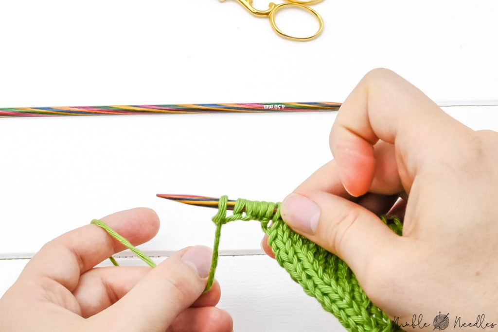 casting on stitches with the backward loop increase on the left side of a knitting project