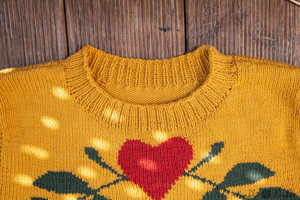close-up of the neckline of this men's intarsia knitting pattern