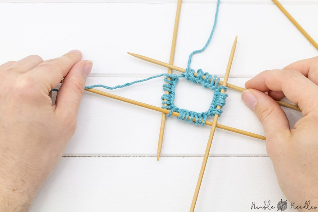 stitches evenly distributed on 4 double-pointed needles