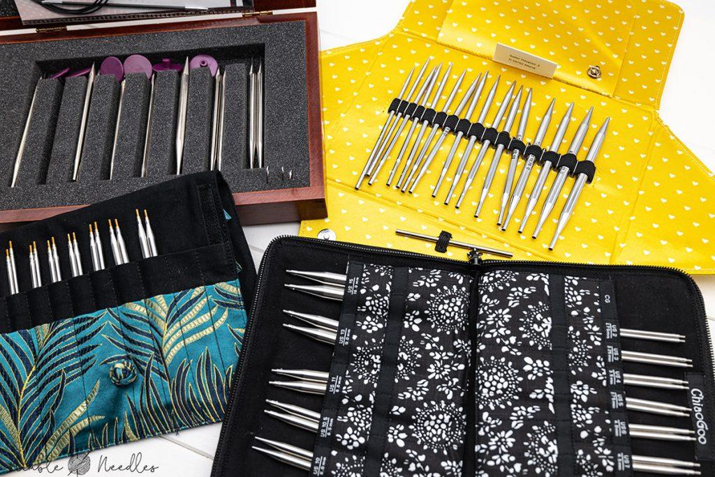interchangable knitting needle sets on a table