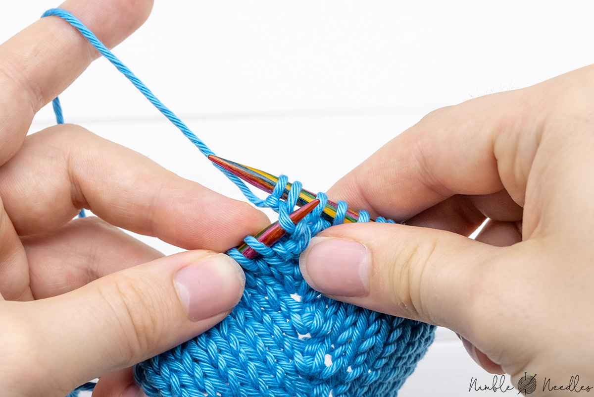 lift the strand between two stitches with your left needle