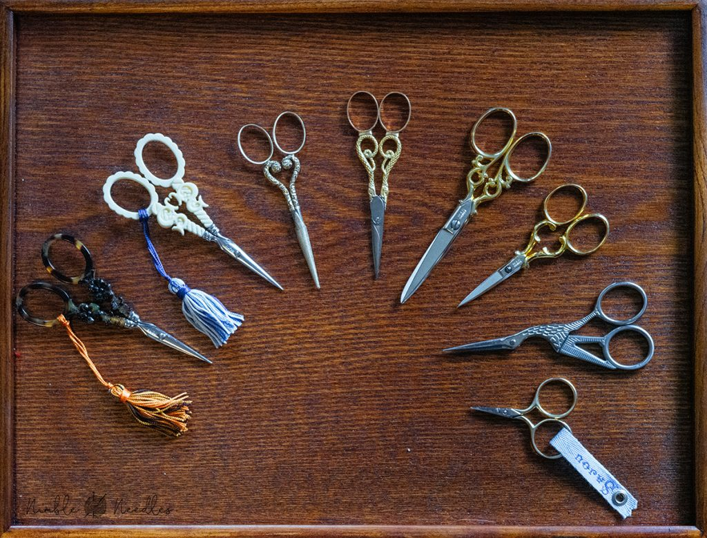 A collection of historic / antique embroidery scissors
