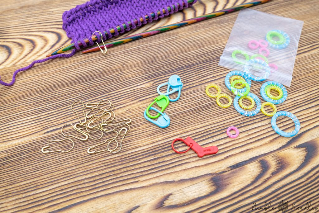 different stitch markers with a little swatch where a stitch marker was used