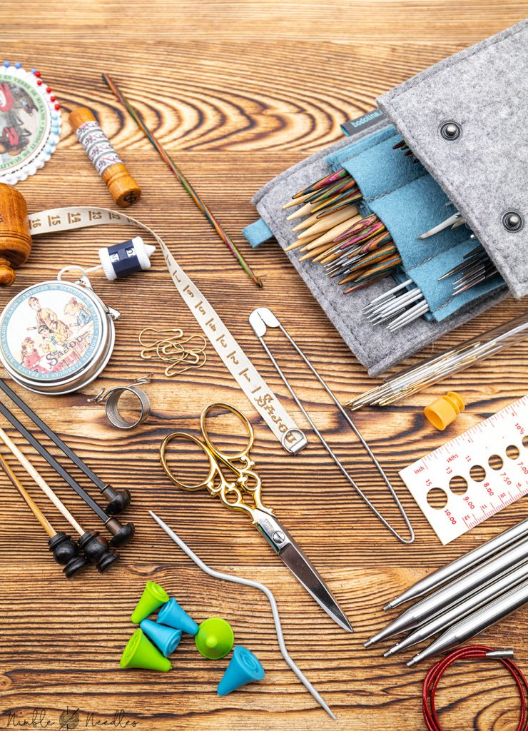 A board full of essential knitting tools and materials every knitter needs