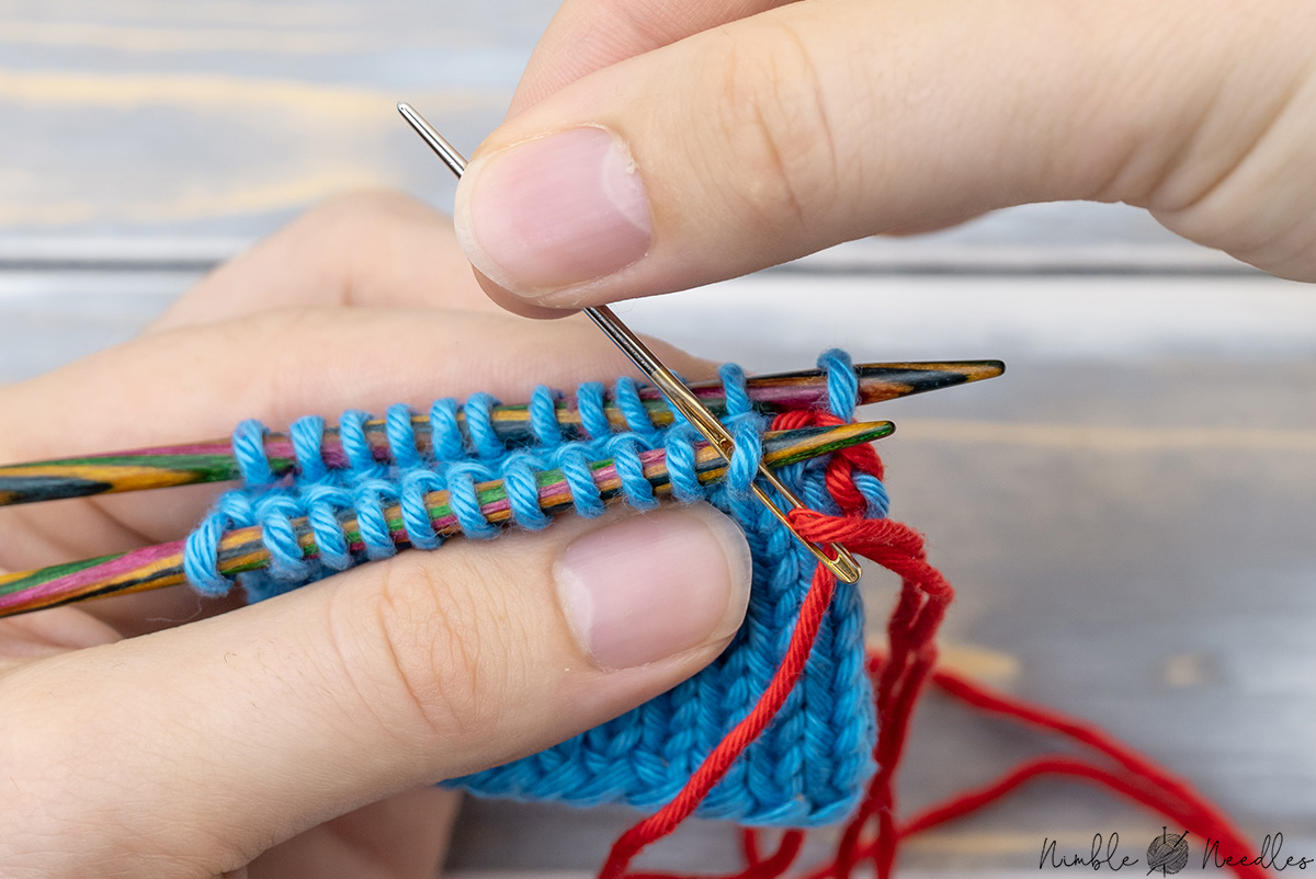 Inserting the needle knitwise and keeping the stitch on the needle