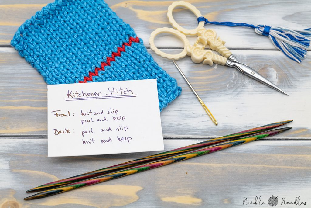 A little cardboard card with the kitchener stitch instructions written on it