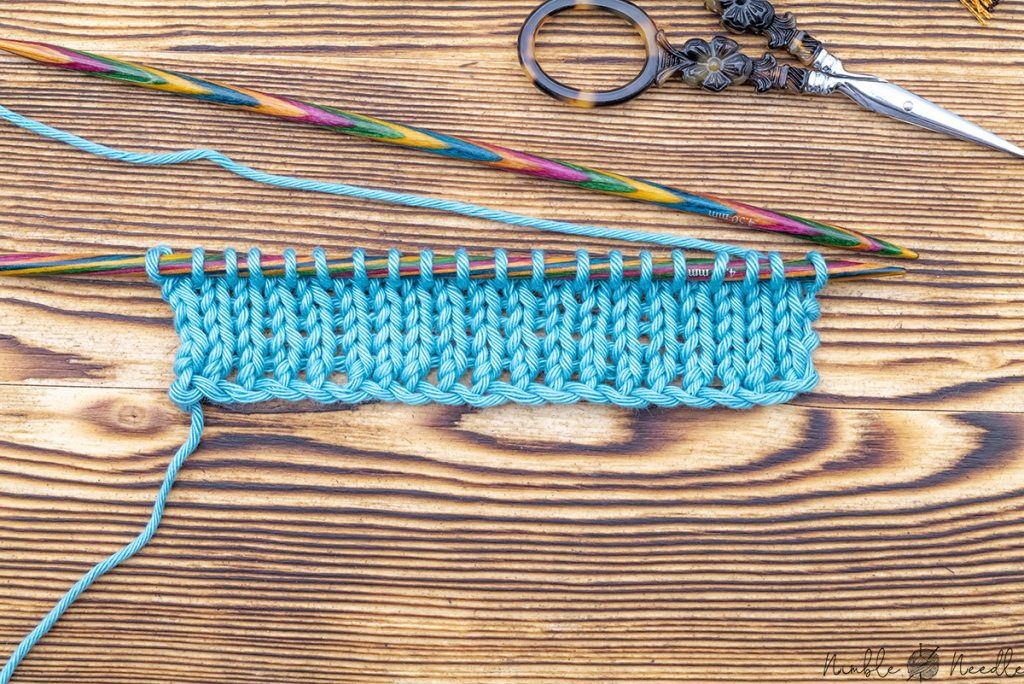 A swatch with a knitted cast on in a blue cotton yarn