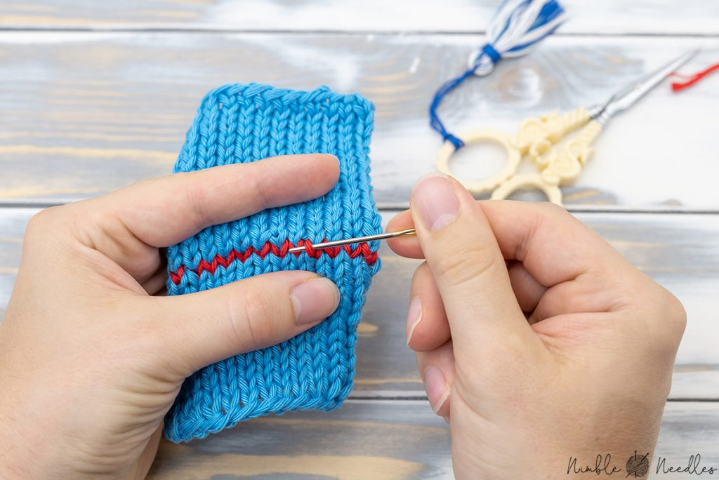 Tightening up the graft stitches of a kitchener stitch join with a tapestry needle