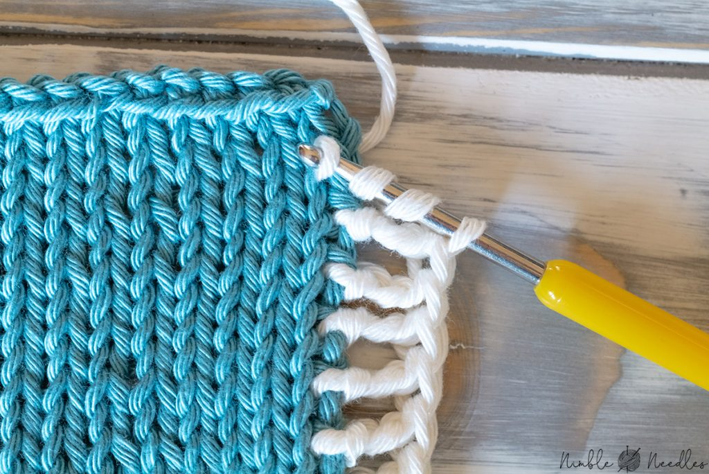 picking up a border with a crochet hook in a contrasting yarn