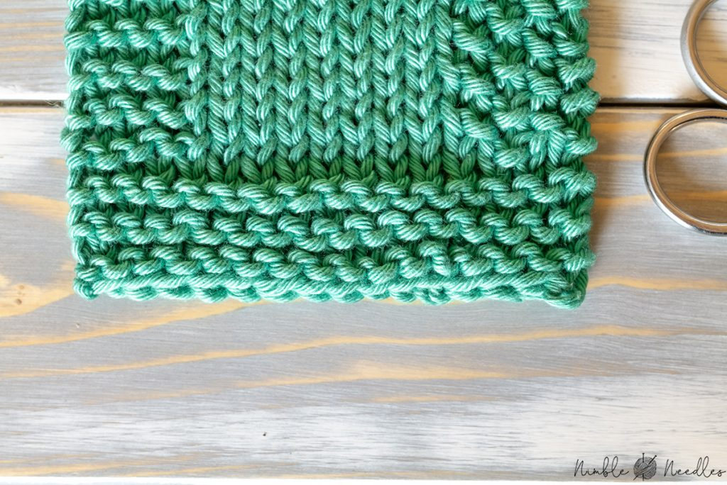 close-up of a simple garter stitch hem so it doesn't curl at the bottom