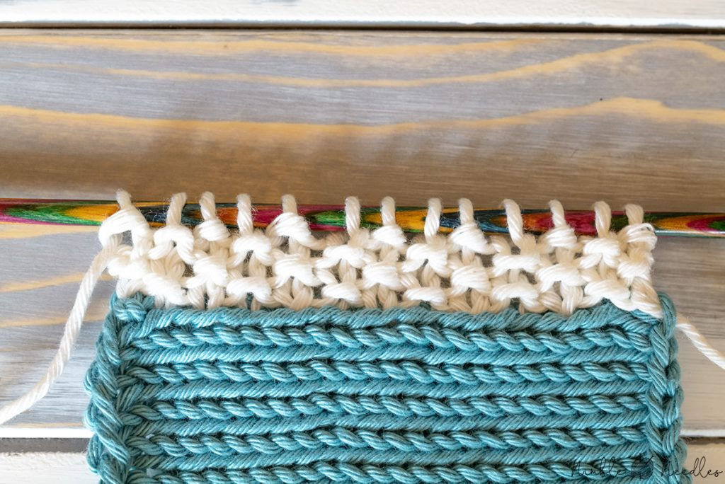 a knitted edge in seed stitch by picking up extra stitches from the edge