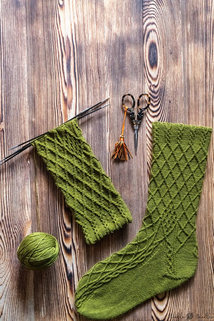 two socks knit in bavarian twisted stitches