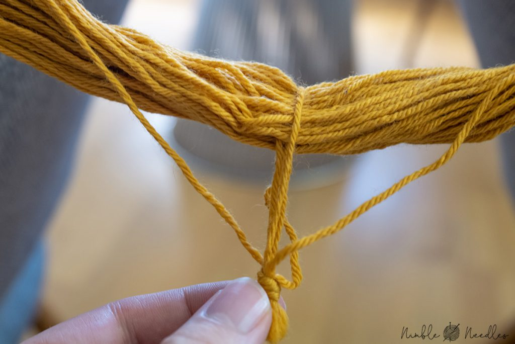 the knot securing the hank of yarn and where you need to cut it